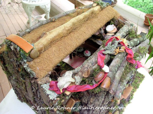 From above the fairy house shows thatched roof.